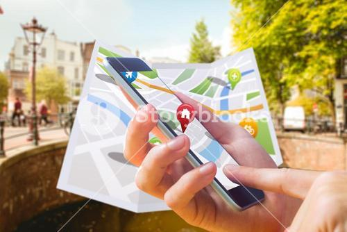 Composite image of man using map app on phone