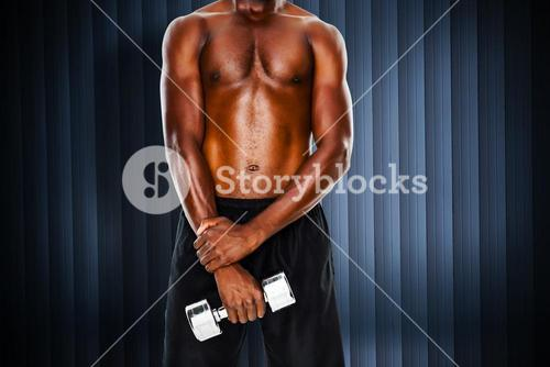 Composite image of mid section of fit shirtless man holding dumbbell