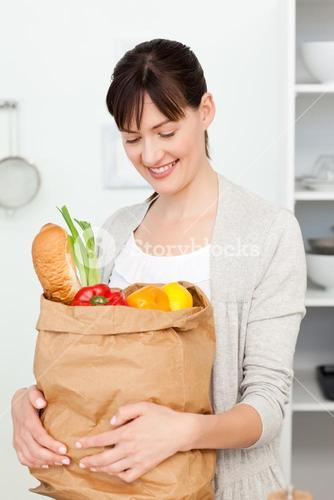 Woman with shoping bags in the kitchen