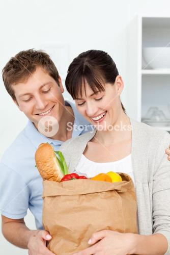 Adorable couple looking at shoping bags