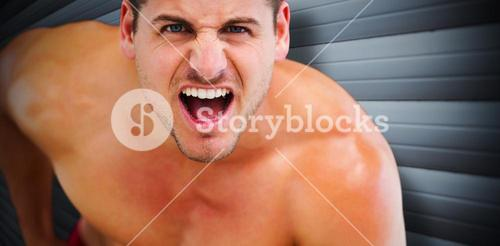 Composite image of bodybuilder shouting