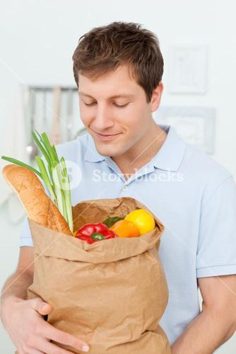 Man with shoping bags in the kitchen