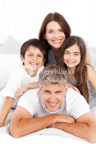 Happy familly looking at the camera
