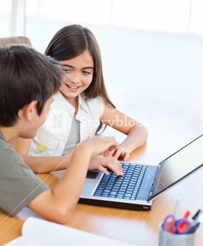 Children working on their laptop at home