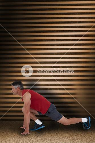 Composite image of fit man stretching his legs