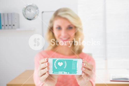 Composite image of pretty blonde showing her smartphone