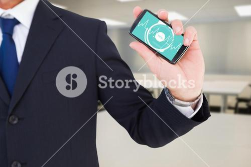 Composite image of mid section of a businessman typing on his phone