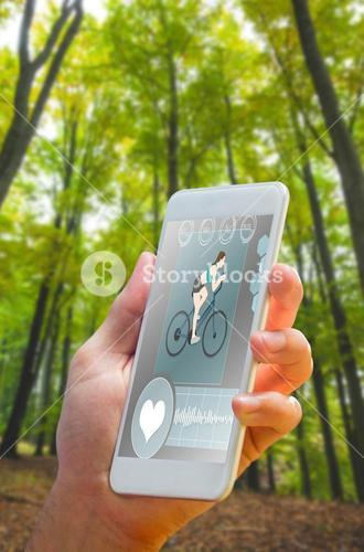 Composite image of hand holding smartphone
