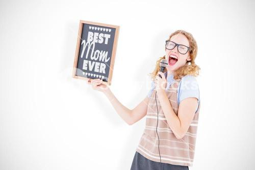 Composite image of geeky hipster woman holding blackboard and singing into microphone