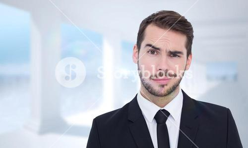 Composite image of portrait of a skeptical businessman well dressed