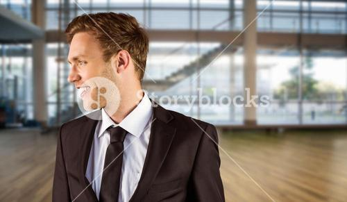 Composite image of young handsome businessman looking away