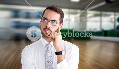 Composite image of portrait of a businessman with glasses thinking