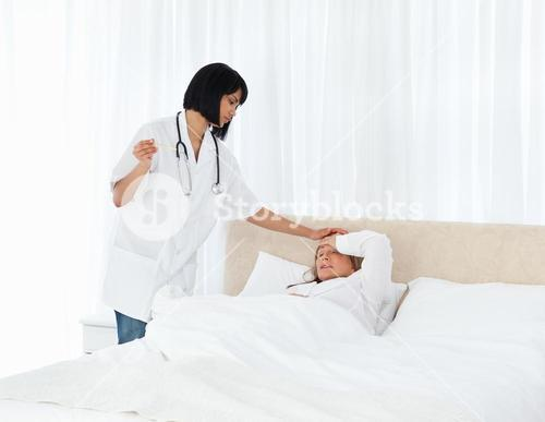 Nurse taking the temperature of her patient