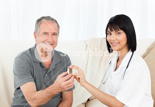 Retired man with his nurse looking at the camera