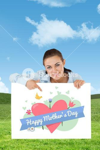 Composite image of businesswoman pointing on sign under her