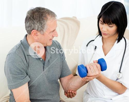 Nurse helping her patient to do exercises