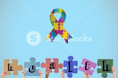 Composite image of hands holding up health jigsaw pieces