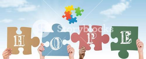 Composite image of hands holding up hope jigsaw pieces