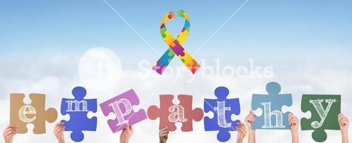 Composite image of hands holding up empathy jigsaw pieces