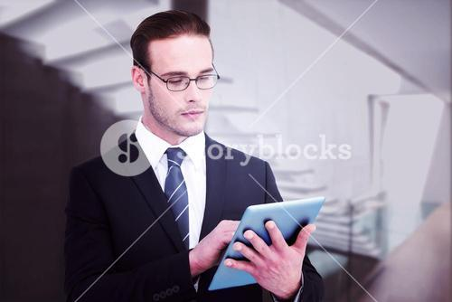 Composite image of unsmiling businessman using tablet pc