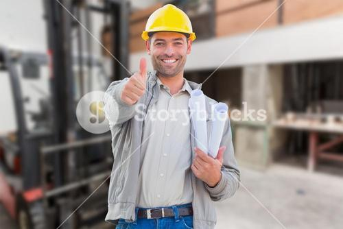 Composite image of architect showing thumbs up