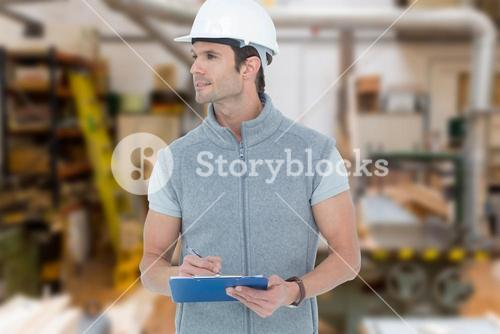 Composite image of architect writing on clip board
