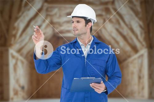 Composite image of supervisor inspecting while holding clip board