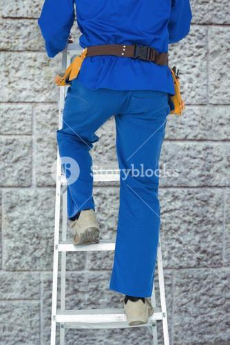 Composite image of low section of carpenter climbing step ladder
