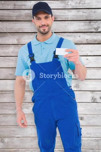 Composite image of handyman holding visiting card