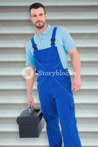 Composite image of repairman with toolbox