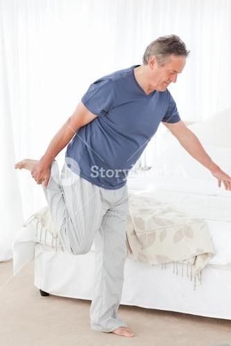 Mature man stretching