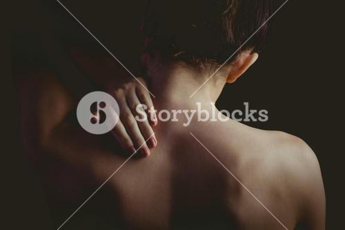 Nude woman with a neck injury