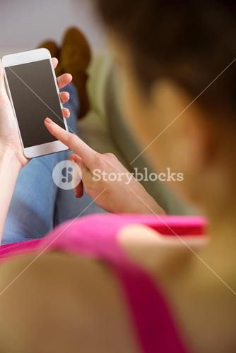 Casual woman using her smartphone