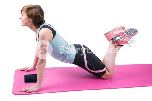 Pretty brunette doing press up on fitness mat