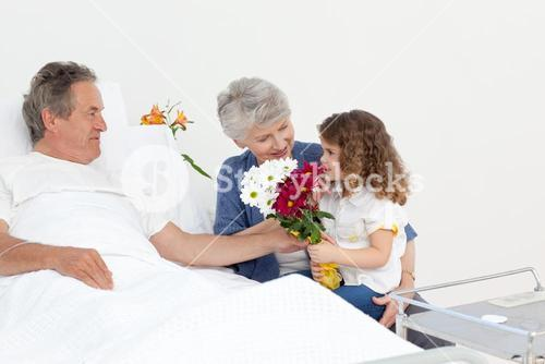 A little girl talking with her grandparents