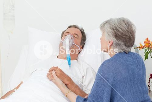 Old women taking care of her husband