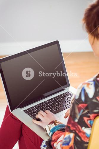 Slim woman using a laptop