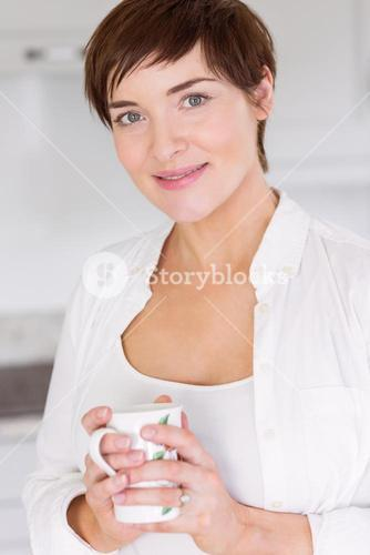 Pregnant woman having a hot drink