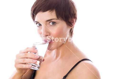 Pregnant woman drinking glass of water