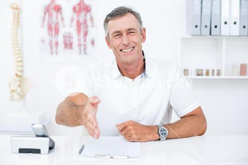 Smiling doctor offering his hand