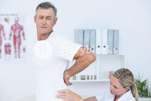 Doctor examining her patient back