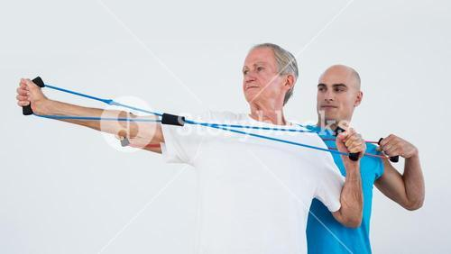 Old man stretching elastic