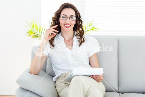 Smiling therapist taking notes