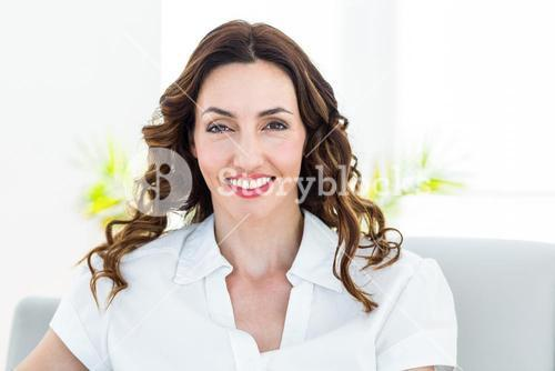 Smiling therapist looking at camera