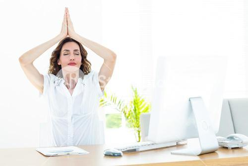 Relaxed businesswoman doing yoga