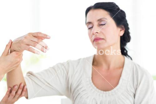 Therapist holding her patients arm