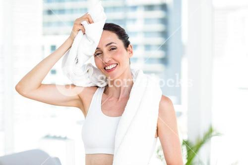 Brunette wiping her forehead with towel