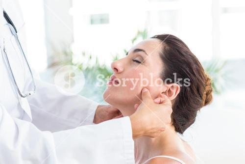Doctor examining her patients jaw