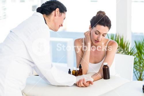 Doctor doing skin prick test at her patient