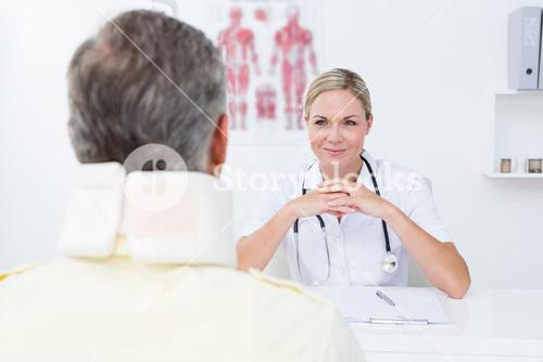 Doctor looking at patient wearing neck brace